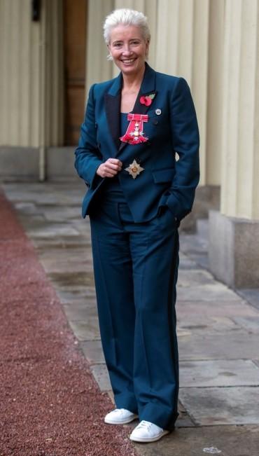 Emma Thompson wears trainers and a tuxedo to Buckingham Palace