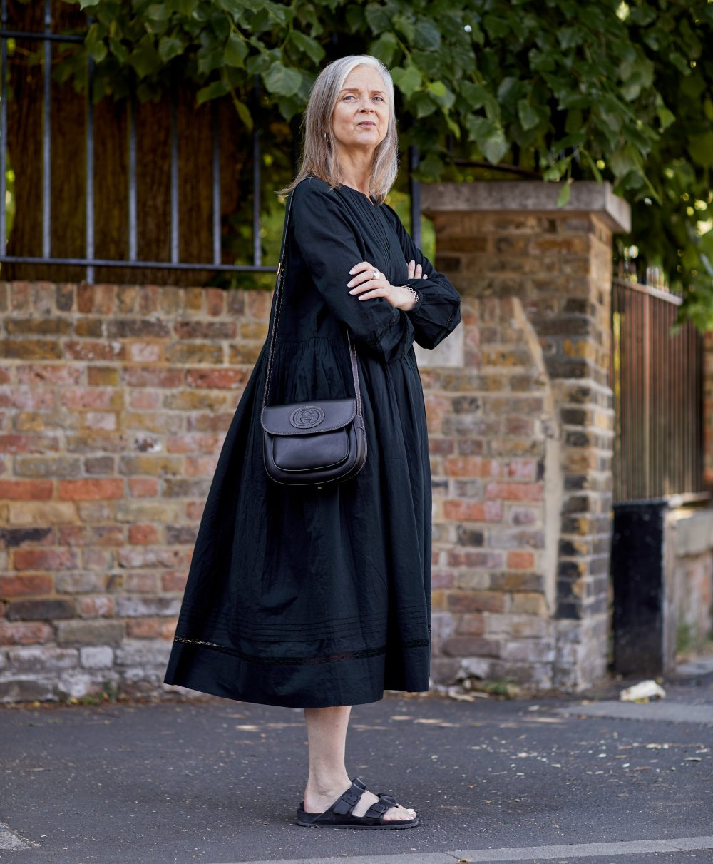 Yes, you can wear a black dress on a hot day
